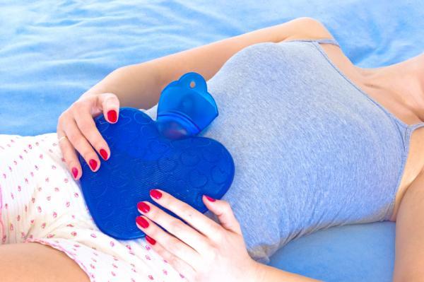 Consejos para la menstruación: desencadenando su período: aplicación de calor